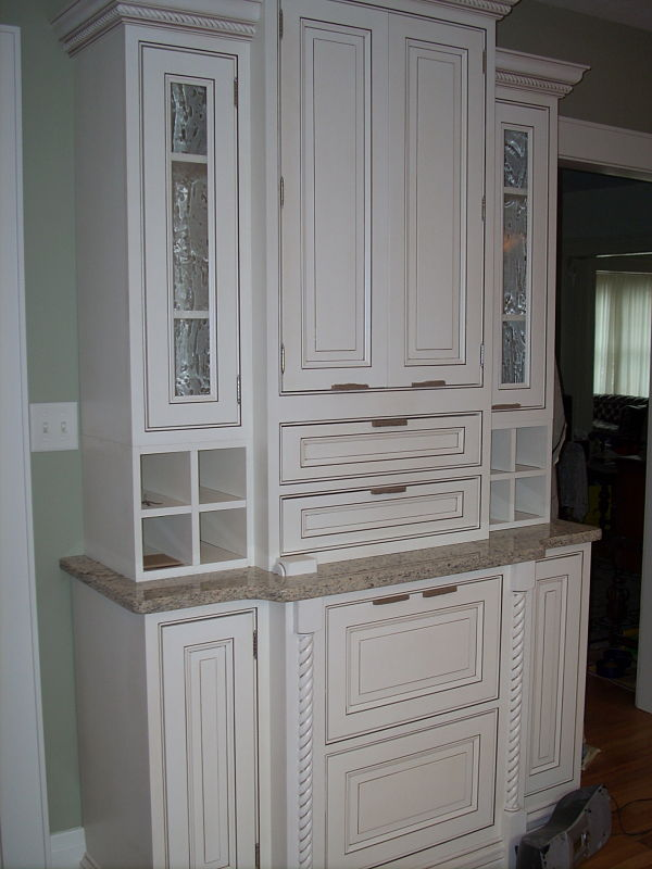 the glazed paint on these new kitchen cabinets brings out all of the details of the
