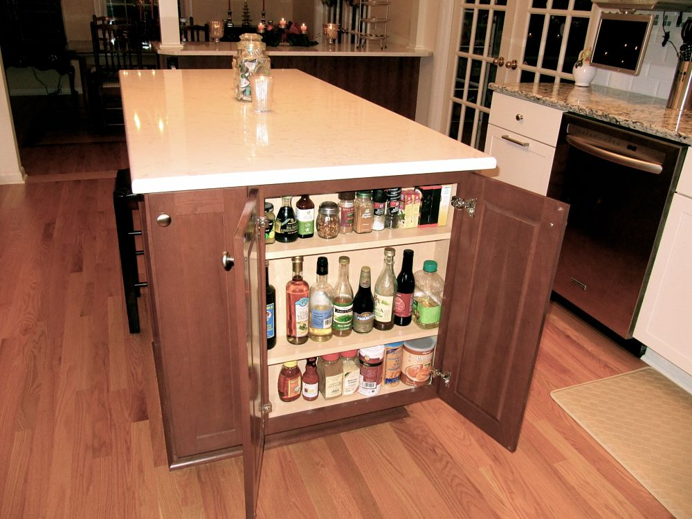 the island in the kitchen serves many functions oils vinegars and