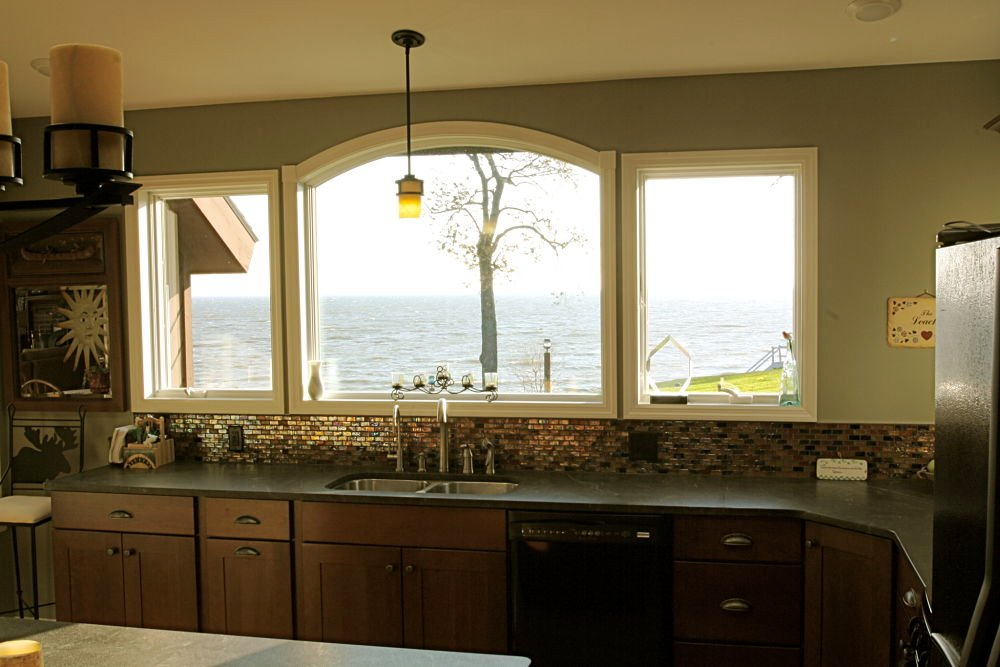 Three large windows bring light and the lake view into the home.