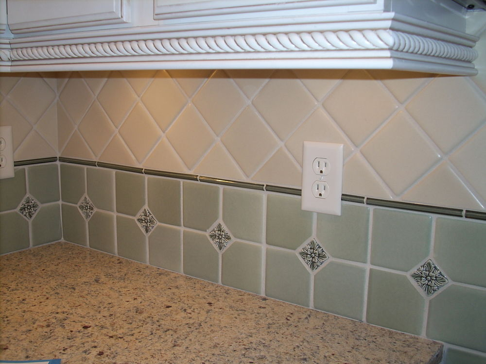 The five different size tiles and the changes to the tile direction make some fairly simple tiles into a beautiful backsplash.