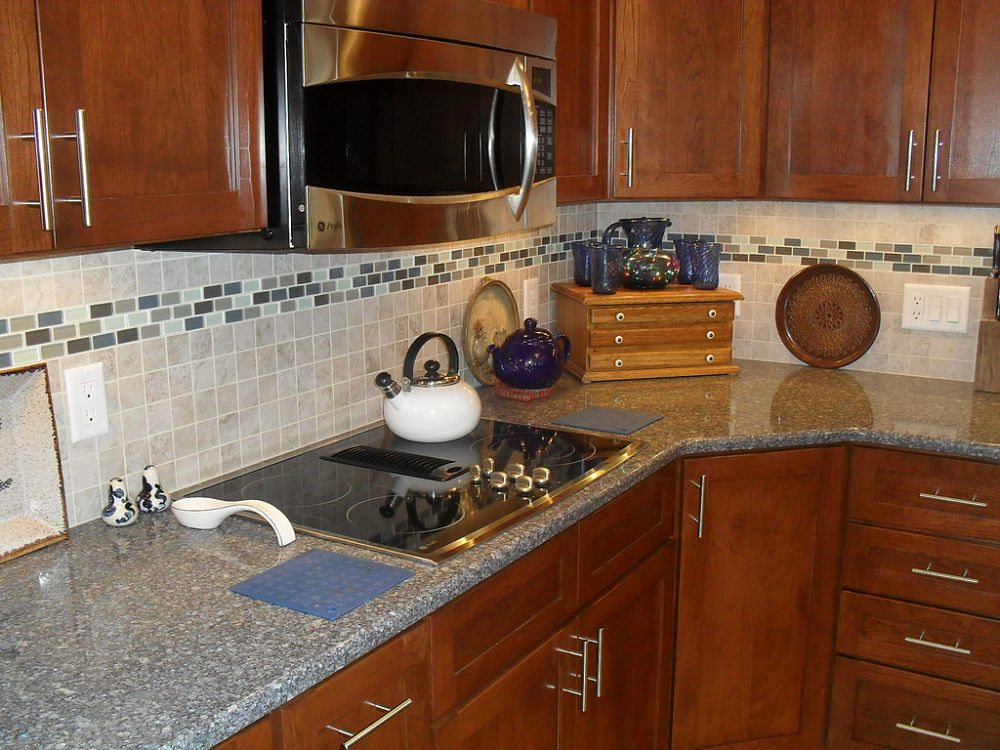 The Ceramic Tile Backsplash With A Glass Tile Accent Add Color And Function  To This Kitchen