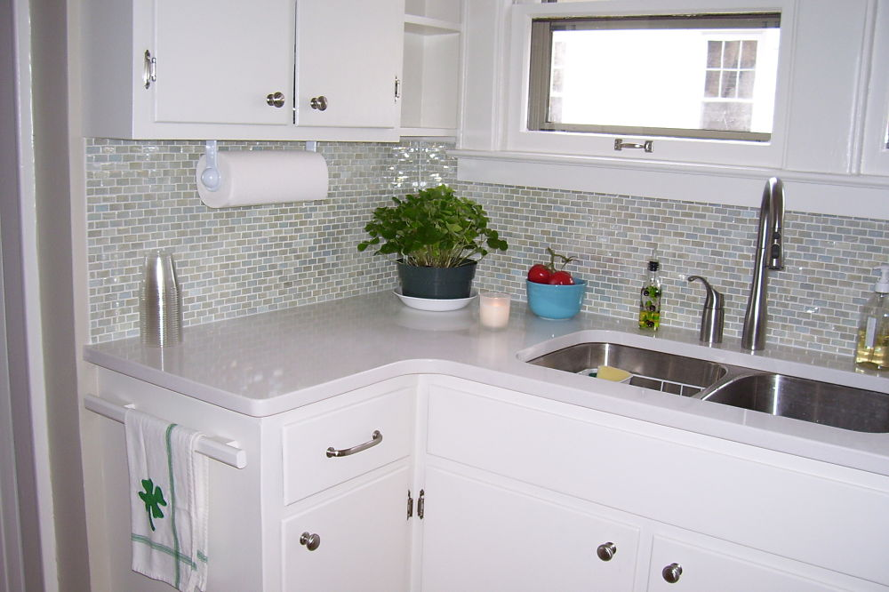 Adding New Counters A Glass Tile Backsplash And Painting The Cabinets Created A Nice Upgrade
