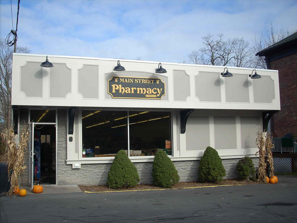 The exterior of this pharmacy was updated with a new simple paneled look. A new prescription area was built which included all new custom cabinetry and some new shelving to hold the supply of medicine. The cabinetry was built to meet the specific needs of the pharmacy.