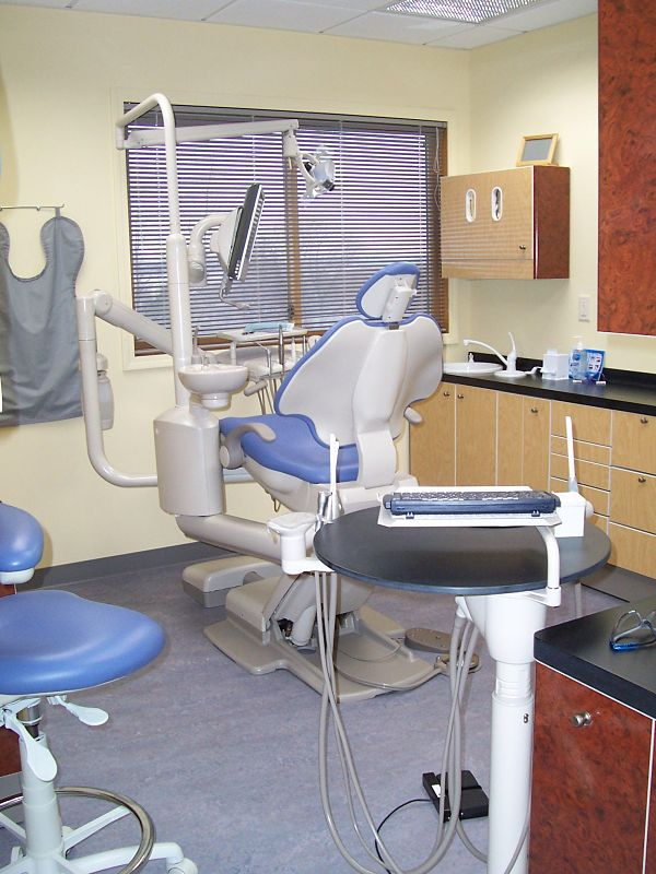 This project had both design and technical challenges. The room houses dental x-ray machines, dental equipment including drills and sinks, special lighting fixtures and wiring for chair operation. Along with code considerations, the space needed to be made patient friendly. Aesthetics were as important as the utilitarian design of the room. The dental cabinetry selected for this office provides essential storage. Two different laminates were used to bring color to the room. A vinyl floor was installed throughout the operatories for easy cleaning and low maintenance. The room was painted yellow to brighten patient's spirits.