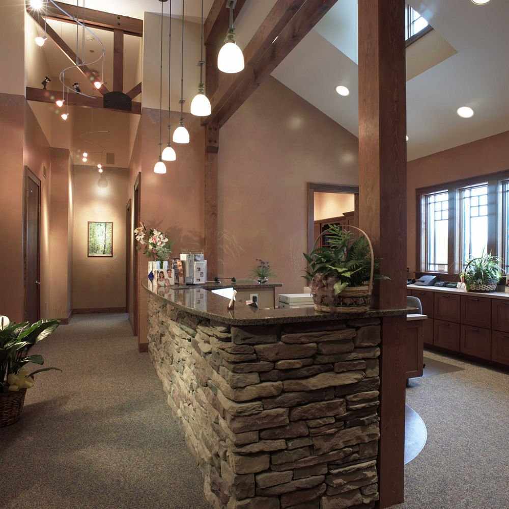 The outdoors has been brought in with the use of cultured stone, false wood beams and trusses, granite countertops and earth tone colored wall paint and carpeting.