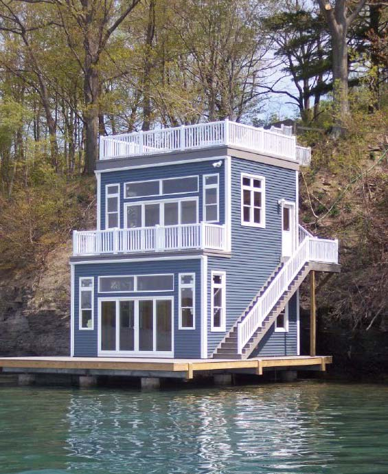 Located on Skaneateles Lake, this boathouse features vinyl siding and windows, two vinyl decks and a large first level deck/dock.