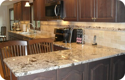 which is better granite or quartz countertops. Black Bedroom Furniture Sets. Home Design Ideas