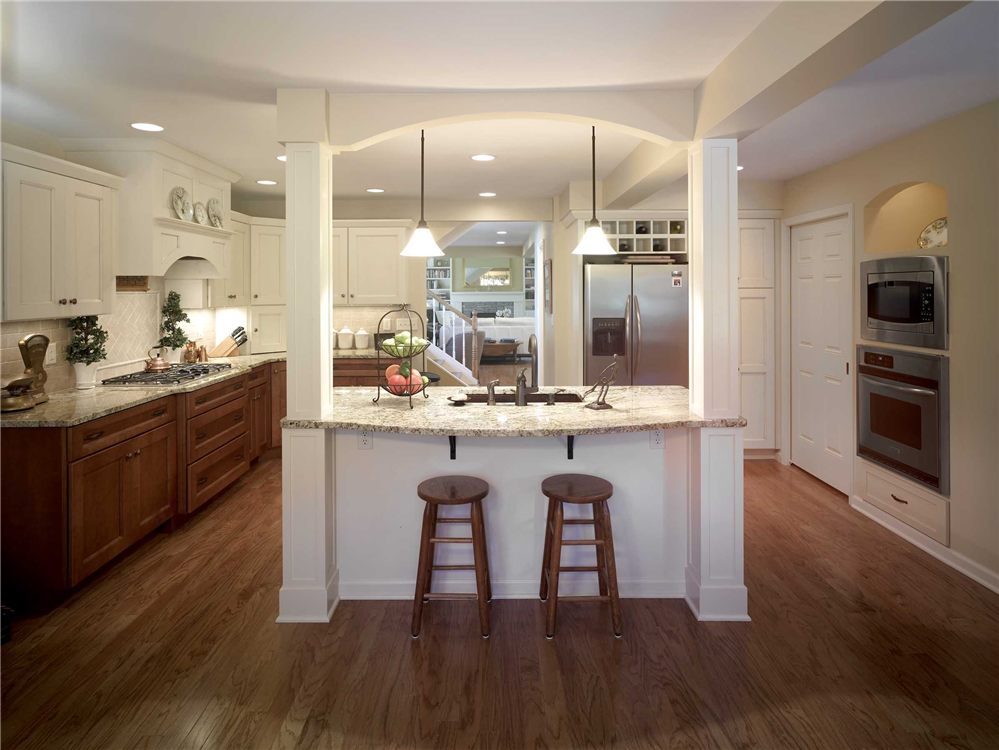 This Exquisite Kitchen Features An Island With Two Paneled