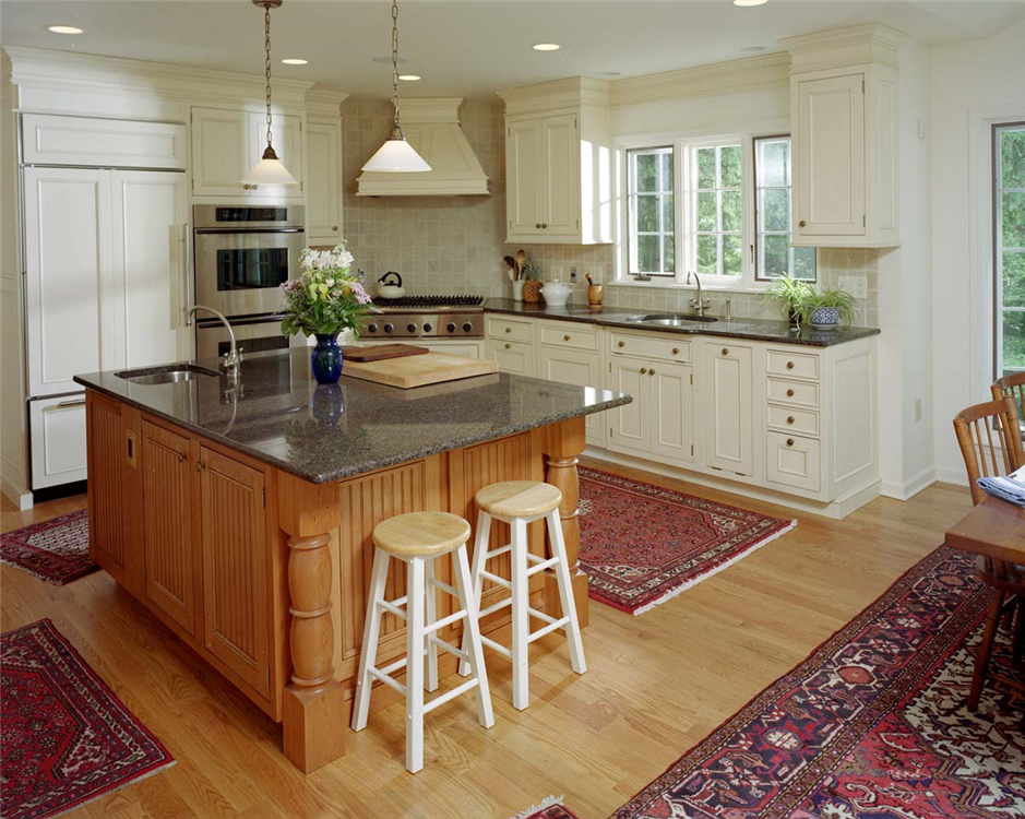 This kitchen blends modern elements such as the built in for Triangle kitchen island