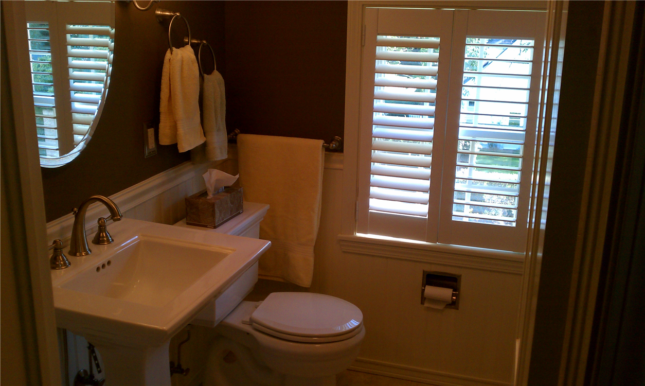 Dark Color Painted Walls White Wainscoting A White Pedestal Sink And Brushed Chrome Fixtures