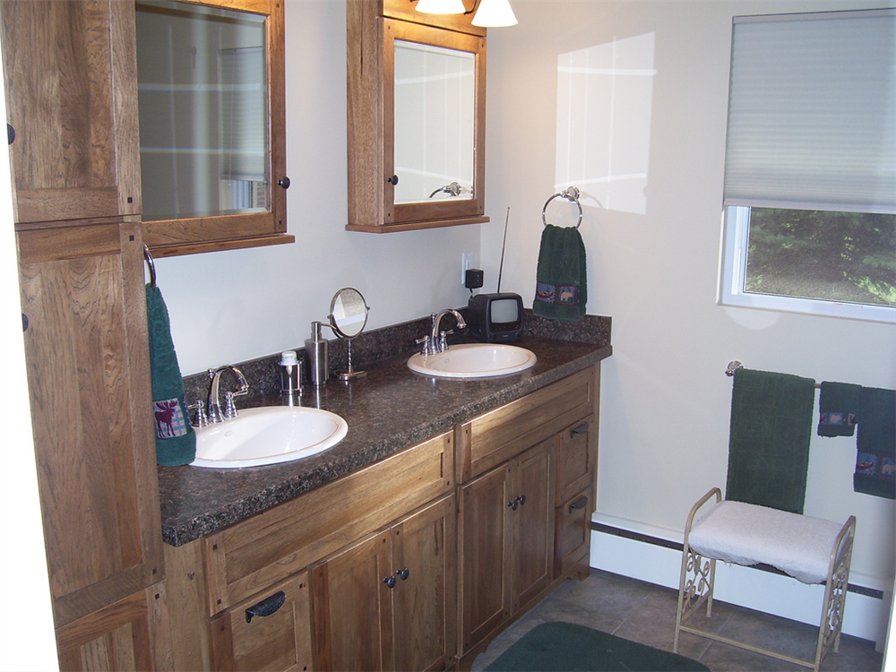 The two medicine cabinets large vanity and linen cabinet create plenty of storage space in this for Bathroom remodeling syracuse ny