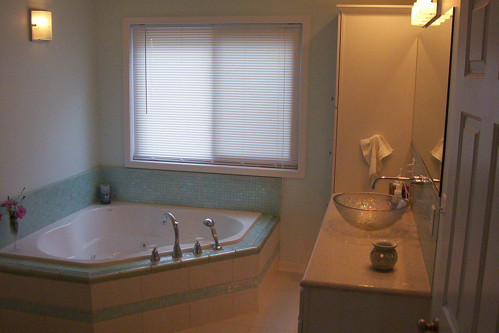 This bathroom remodel included a whirlpool tub with heater surrounded by glass tile to create a for Bathroom remodeling syracuse ny