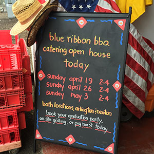 blue ribbon bbq open house sidewalk sign 300px