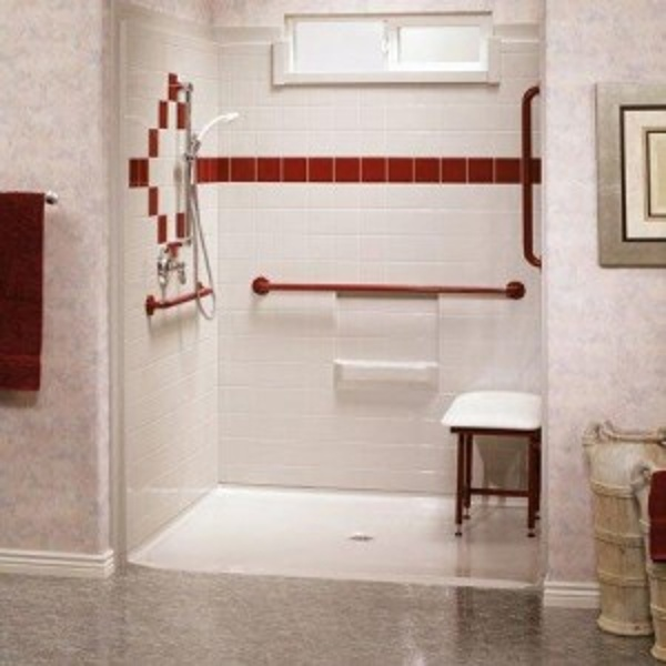 Lowered threshold shower designs