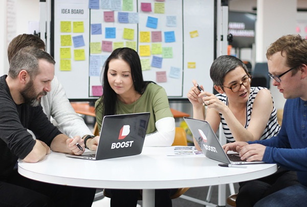 Click the image of a Scrum team to learn how a Product Owner can guide their team to success.