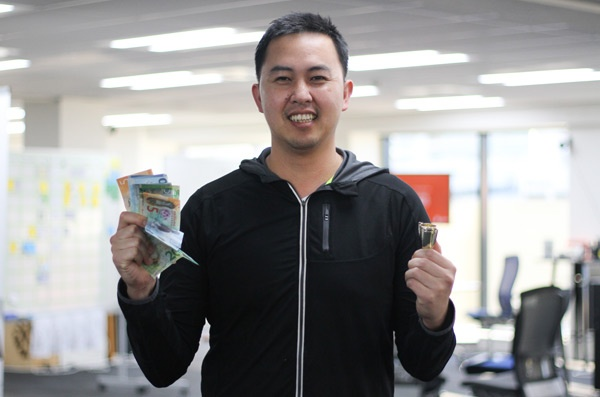 Boost World Cup sweepstake winner Yar celebrate's France's victory with his winnings.