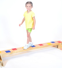 "The Home Balance Beam allows children to use their core muscles to improve balance and agility while walking forward and even backward, for more accelerated users. Plastic hoop obstacles mount into the side holes for an added challenge. (Not shown). (L=72"" W=24"" HT=10"" WT=85lbs.)"