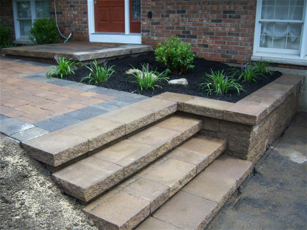 Block retaining wall with paver walkway. Location: Monroe, NY