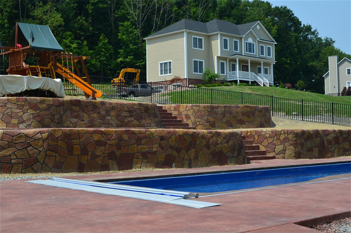 StoneMakers Retaining wall & Leisure Pools Moroccan 34 Fiberglass Swimming Pool in Australian Blue. Location: Highland Mills, NY