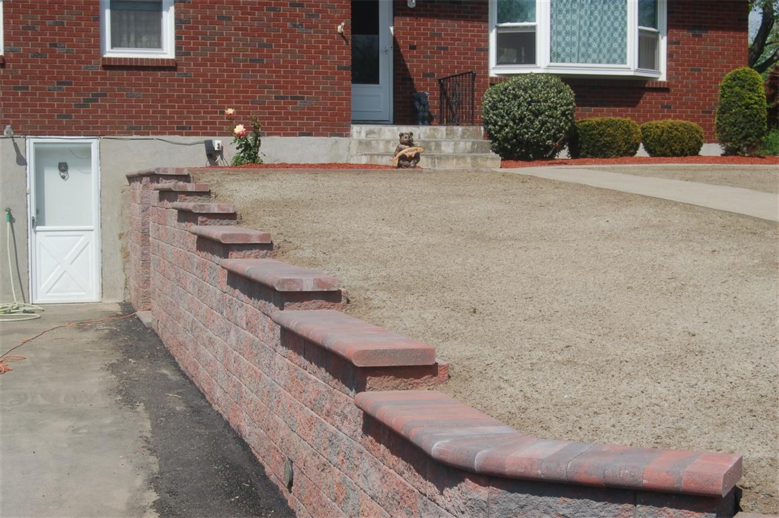 Versa-Lok Standard Retaining Wall with Bull-nose cap in Red Flash. Location, New Windsor, NY