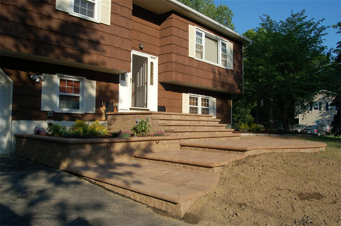 Versa-Lok Retaining wall and free-form stairs with front porch in Butternut. Location, New Windsor, NY