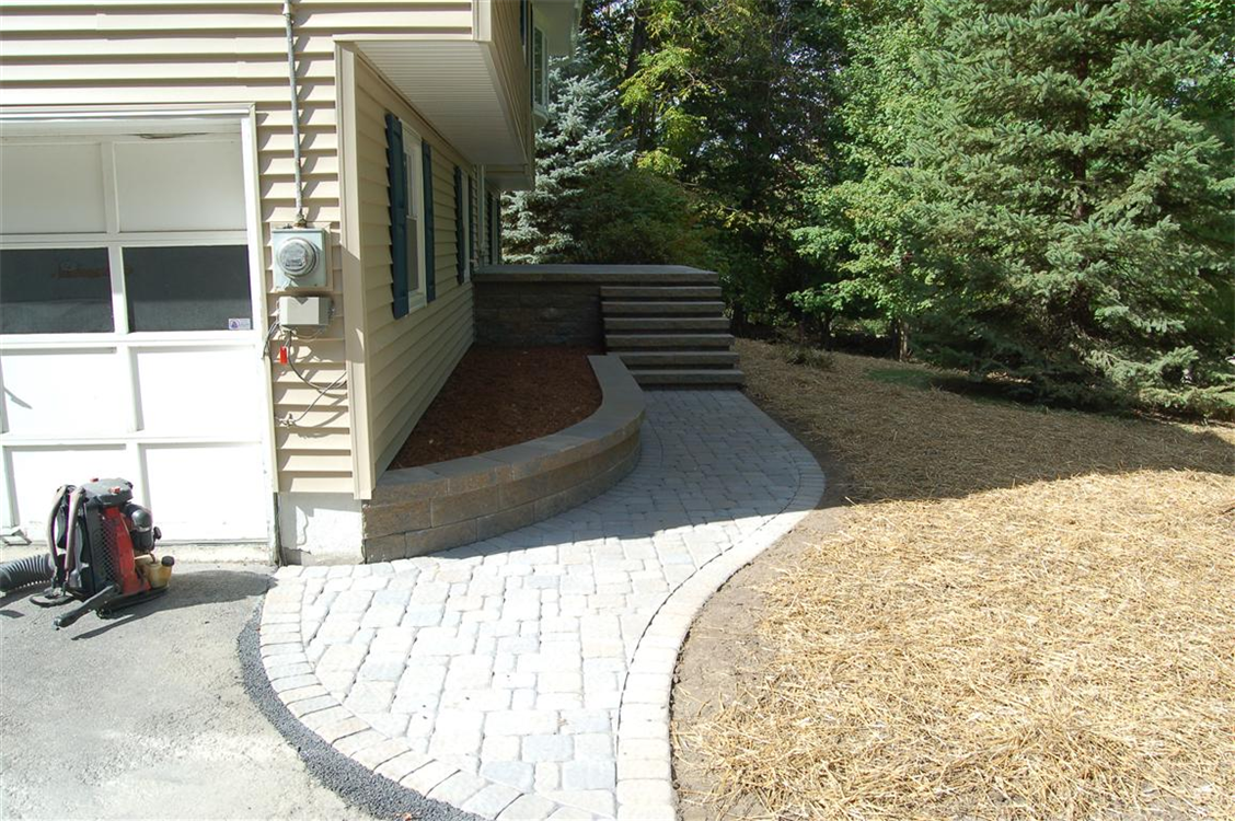 Versa-Lok retaining wall with walkway and front Porch. Location, Cornwall, NY