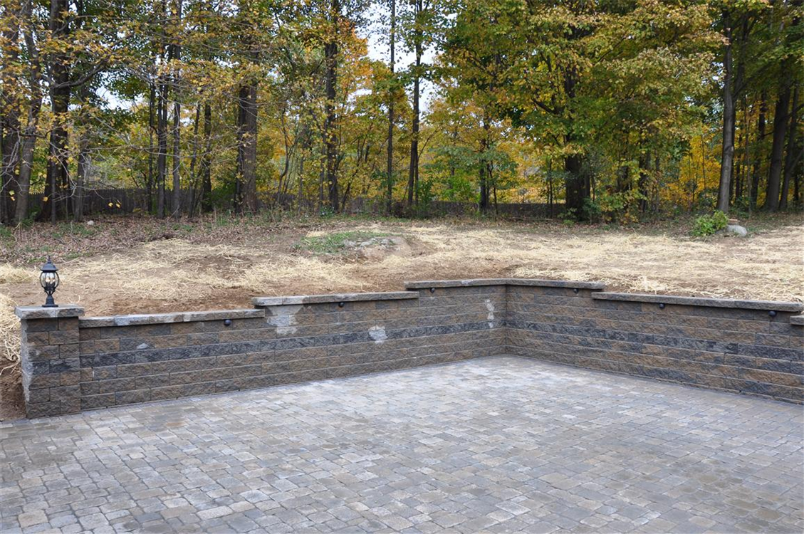 Versa-Lok Retaining wall in Hickory with Antique Grey Stripe and Pillars. Roman Cobble Patio. Location, Newburgh, NY
