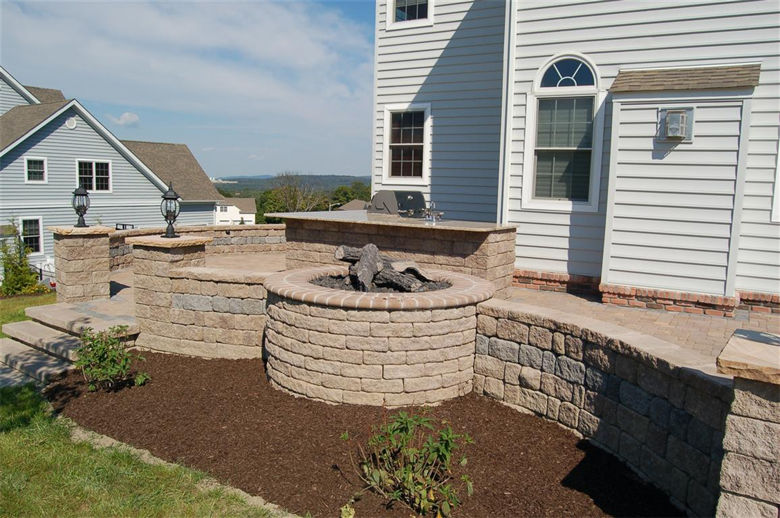 Versa-Lok seating walls in Butternut with Antique Grey Stripe. Fire Pit, Pillars and Outdoor kitchen. Location, Monroe, NY