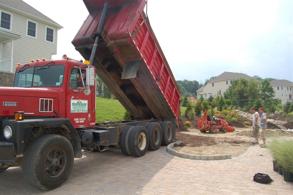 Paver driveway with giant truck on it