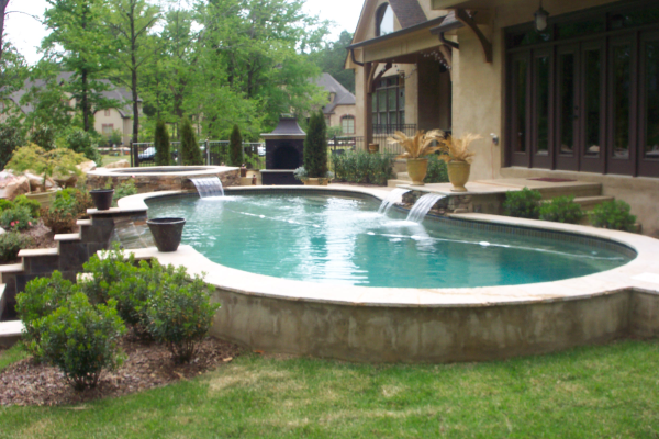 Negative edge spillover fiberglass pools for Fiberglass pool installation