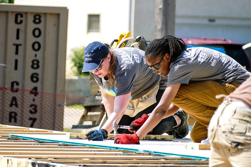 Volunteers working on the House that Beer Built
