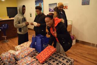 Residents with presents at the event for Khan residents.