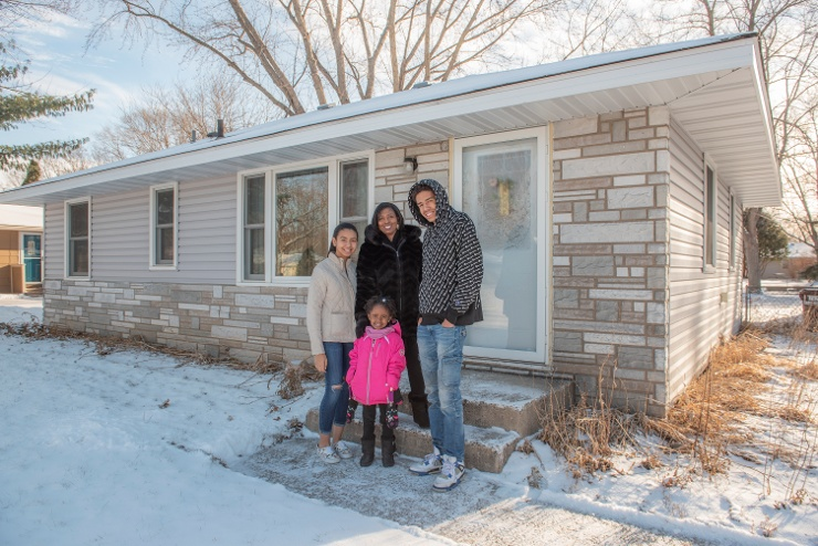 LaShonda's family stand in front of their Habitat home