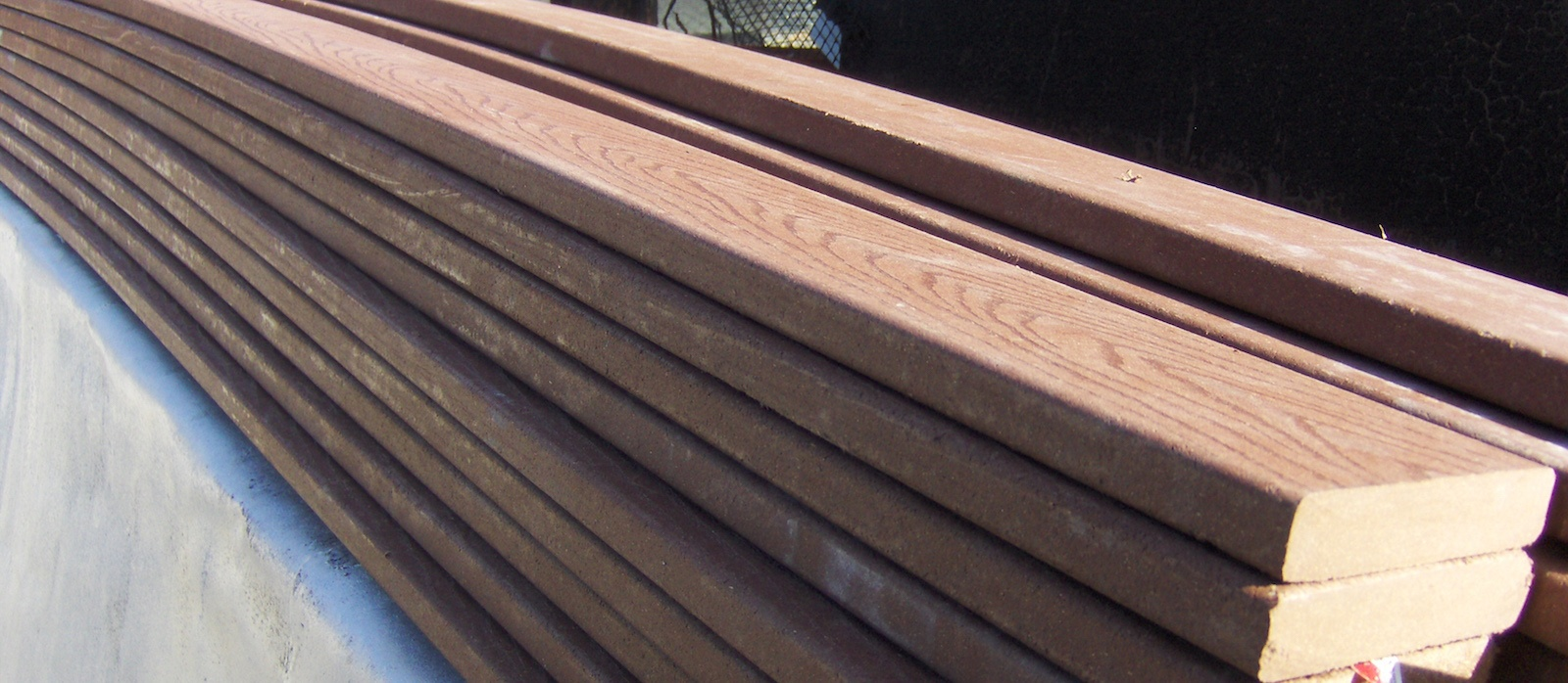 Trex composite decking vs permatrak concrete boardwalk for Timber decking materials