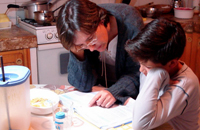 engaged parent assisting with homework