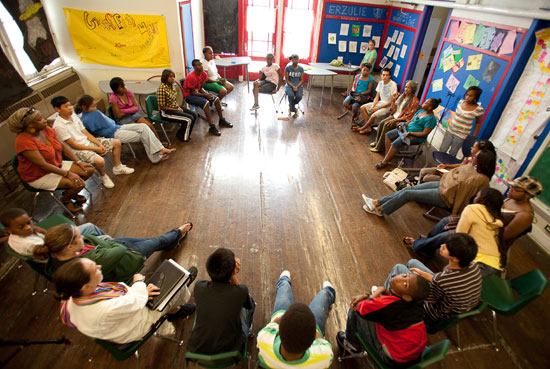 students gather in a circle