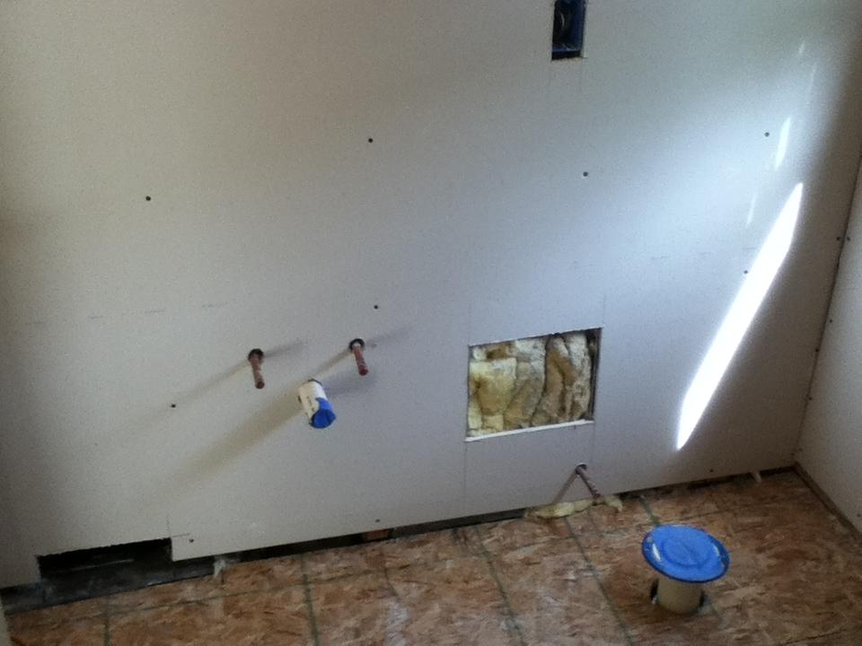 Vanity Area With New Drywall Installed. Vanity Plumbing, Stool Plumbing,  Laundry Shoot,