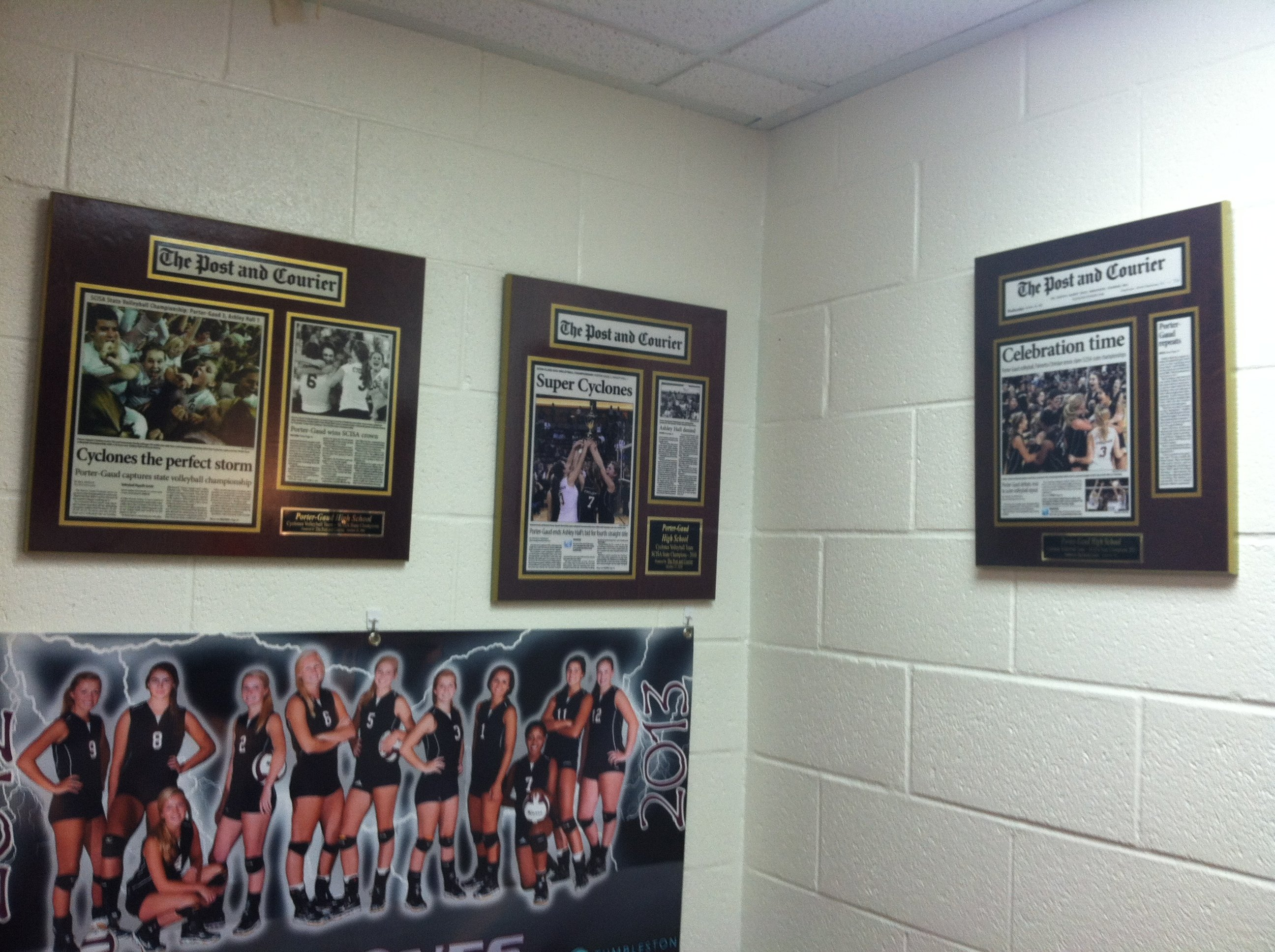 newspaper display frame honors high school volleyball team