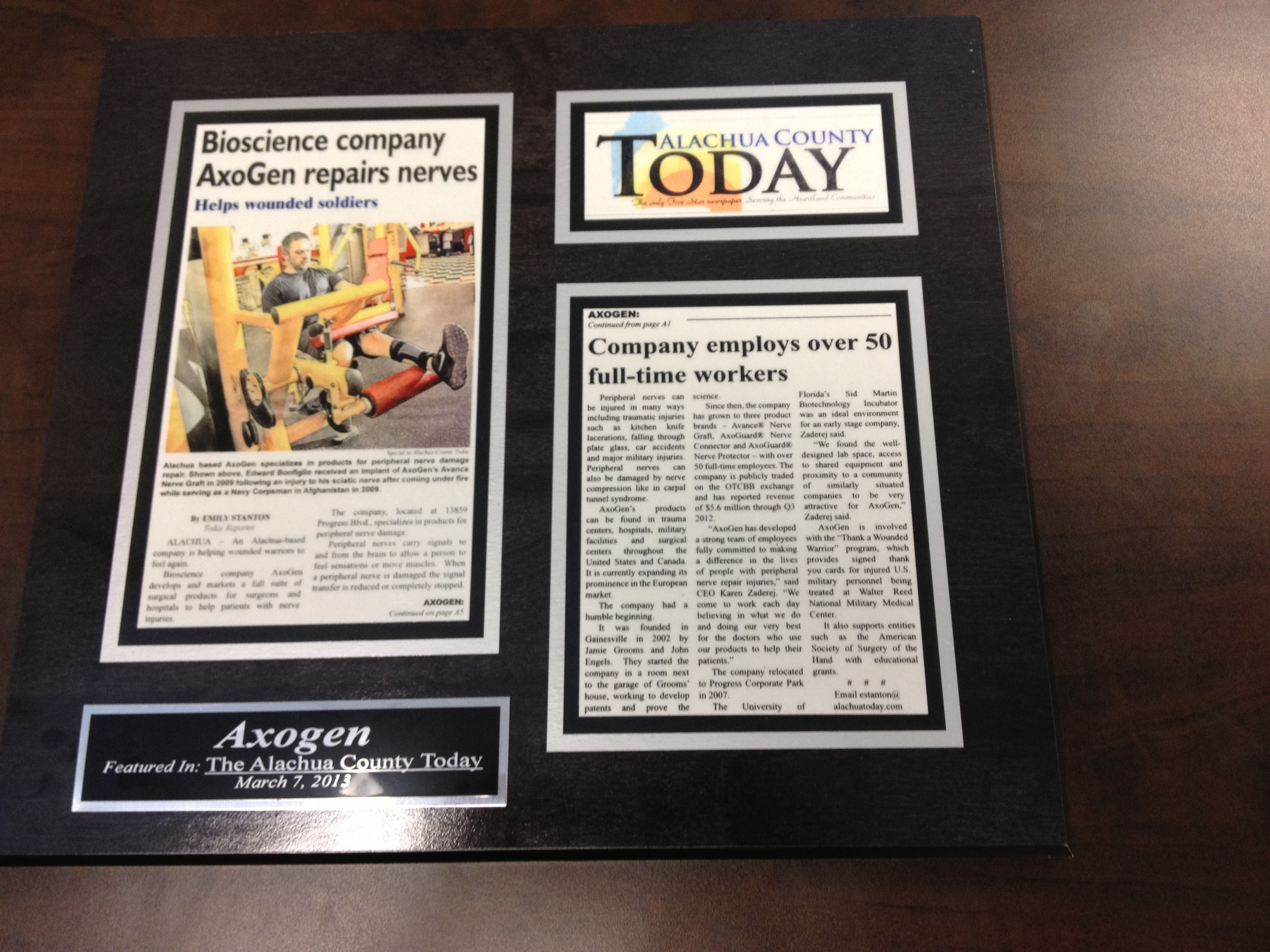 why preserve old newspaper articles with laminated plaques