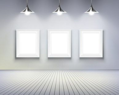 A white wall with three white blank plaques; above them are three white lights