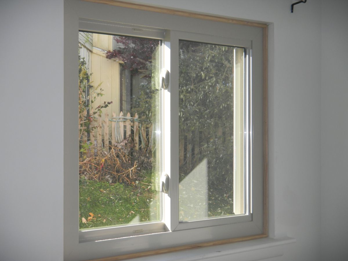 Almond replacement windows with white painted interior trim for Interior windows
