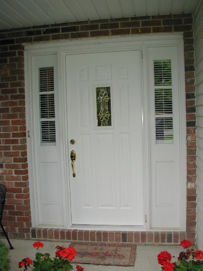 replacement door with small leaded glass window