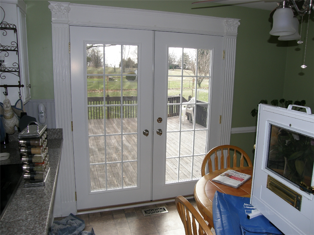 This was originally a twin window now french door to deck for Storm doors for french patio doors