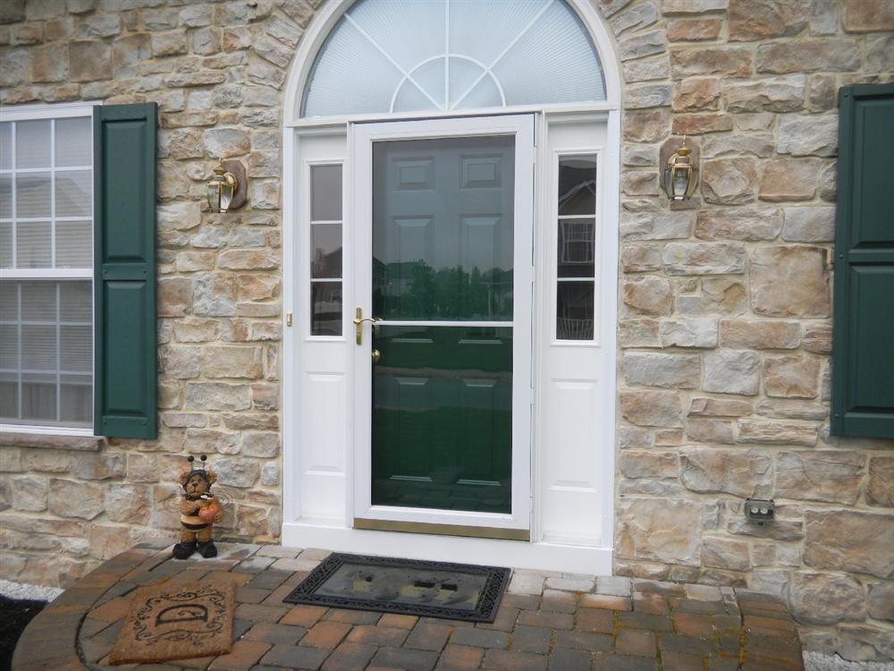 replacement entry door and sidelites with storm door