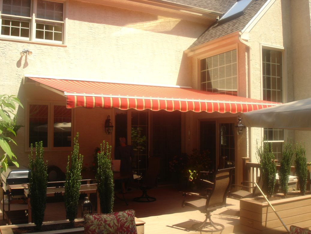 ... color coordinated woven acrylic fabric for motorized retractable awning ... & Retractable Awnings