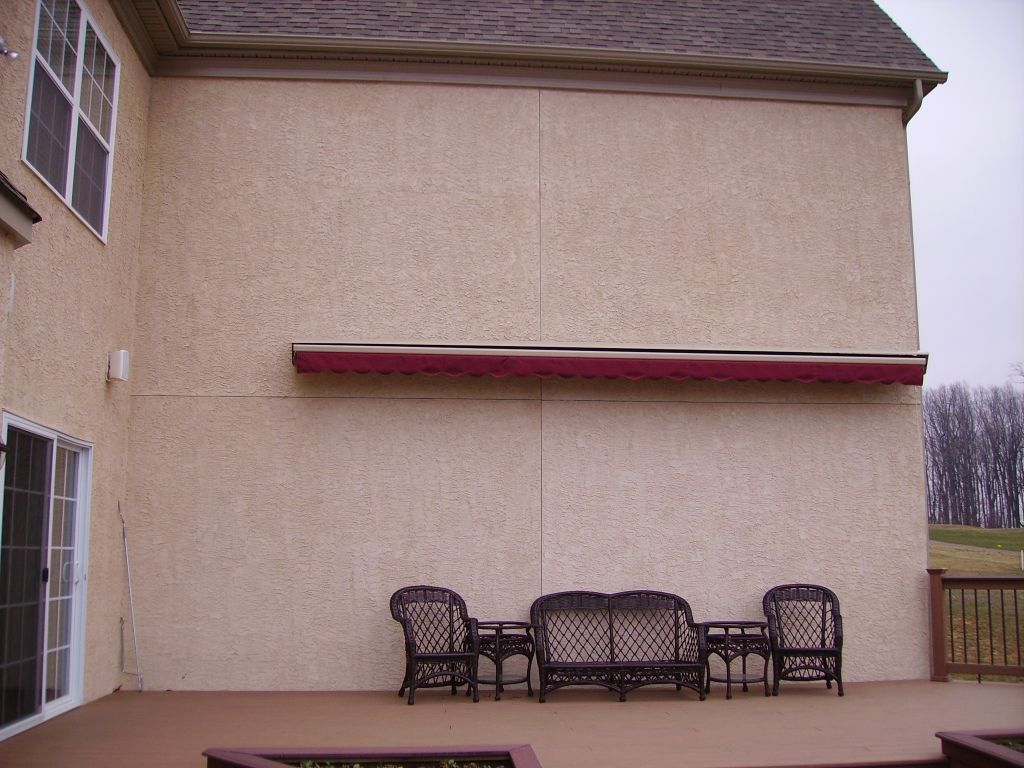 ... Motorized Retractable Awning Mounted On Stucco Wall ...