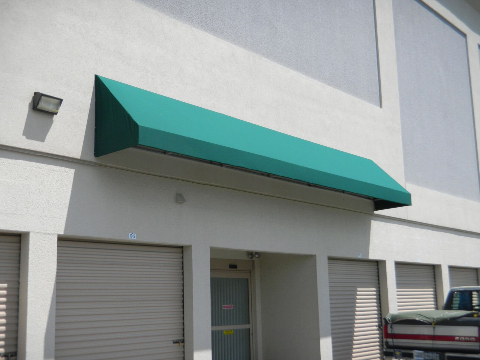 compass lettering signage awning design building