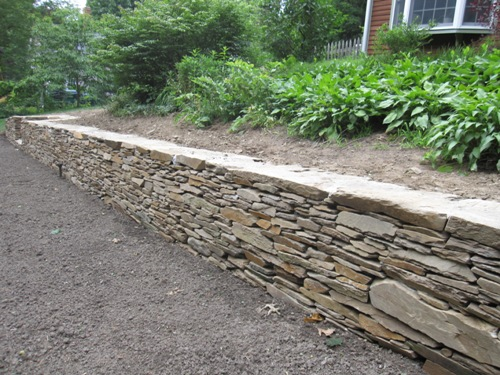 Featured project natural stone retaining wall west for Stone retaining wall design