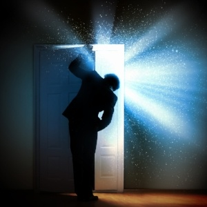 Image of young businessman standing with back opening door-1-237346-edited.jpeg