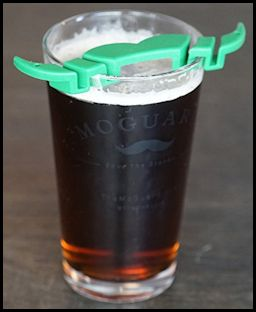 mustache guard on a beer glass